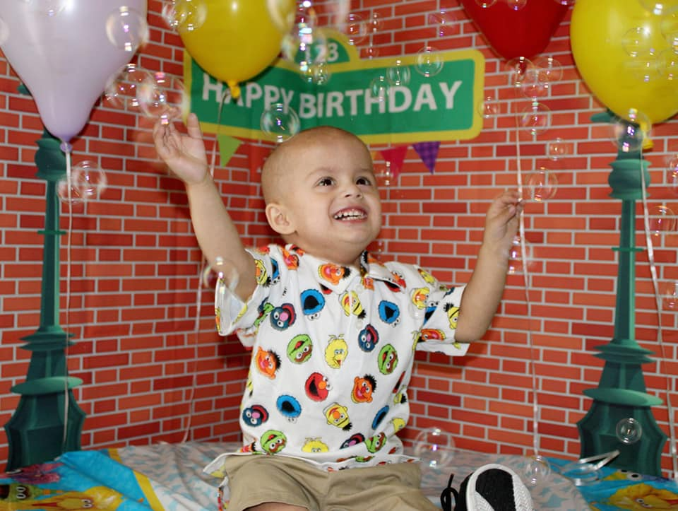 Francisco celebrating his second birthday Sesame Street style
