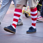 person wearing red and white striped socks walking