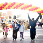 walk for kids participants crossing finish line