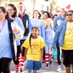 walk for kids participants smile as they receive high fives and walk