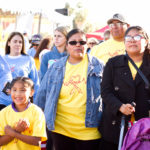 young girl and family walks at the walk for kids 2018 wearing yellow shirts