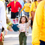 young girl in butterfly shirt and butterfly sweat shirt walk with mother at the walk for kids 2018