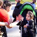 walk for kids 2018 photo will sideline bystander high fiving girl in stroller