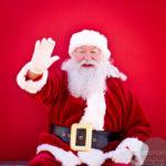 Santa waving and smiling at the walk for kids towards camera