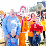 ronald mcdonald and two guests pose for a photo at the walk for kids