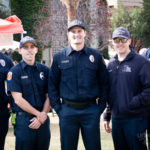 three police officers stand next to eachother at UA Mall for a photo