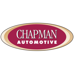 Chapman automotive logo with white writing inside maroon oval outlined with gold