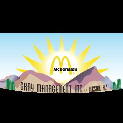 Gray Management Inc Tucson AZ unedr McDonald's golden arches with animated desert scene background